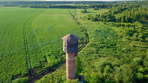 Circling around the water tower. Point of interest. View of the meadow and Footage