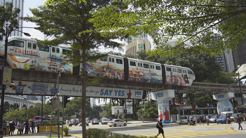 Monorail Commuter Train Crosses above Traffic in Central Kuala Lumpur Footage