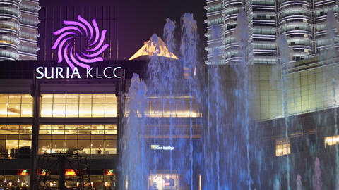 Fountains in front of Suria KLCC in Kuala Lumpur. Upscale Shopping Destination Live Action