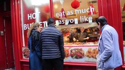 Customers looking through window of Chinese restaurant Chinatown London UK Image