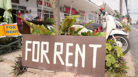 Cars and Motorbikes for Rent Street Sign at Rental Shop in Phuket. 4K. Thailand Footage