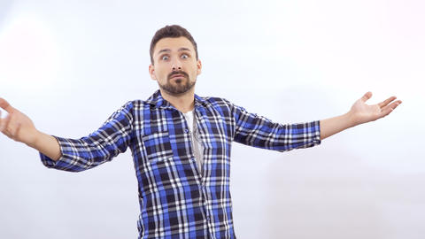 Man scared from something at white background Footage