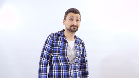 Bearded man posing for camera at white background Footage