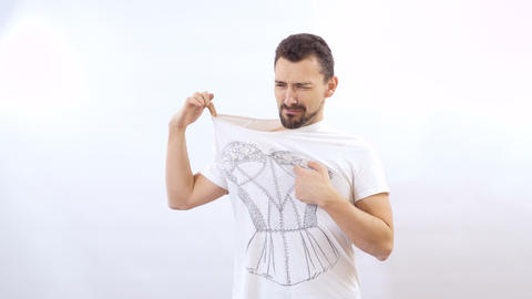Man dislike the print on his t-shirt Live Action
