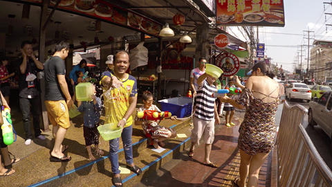 Pouring water on city streets of the during Songkran festival. Thailand Footage