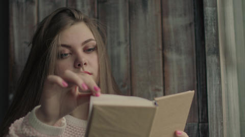 Blonde model read a literature turning pages of the book Footage