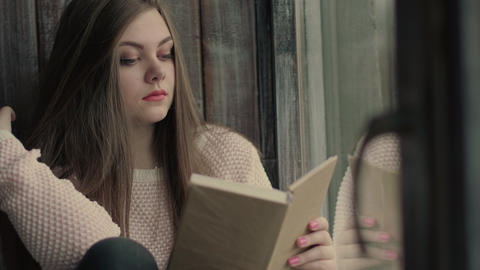 Beautiful young model read a literature turning pages of the book Footage