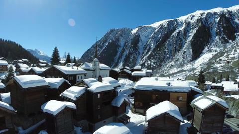 Aerial over snowy winter village Footage