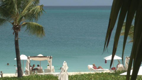Hotel resort cabanas and chairs at oceanfront beach Footage