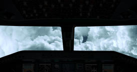 An aeroplane cockpit view flying straight through the clouds in 4k Footage