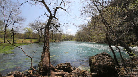 Missouri current river through trees at big spring Footage