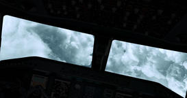 An aeroplane cockpit view flying straight through the clouds while turning right Footage
