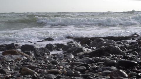 Waves on a stone sea shore Footage