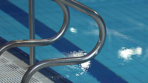 Steel handrails by the pool with water Footage