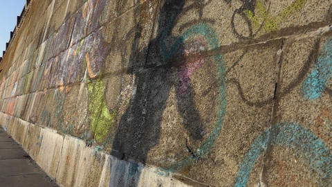 A shadow dancing ballet on a stony wall on a river bank in slo-mo Filmmaterial