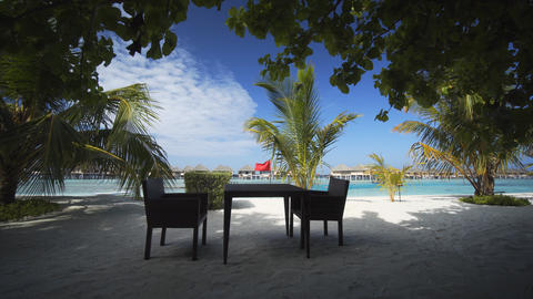Dining Table and Chairs on Vaadhoo Island Tropical Beach Footage