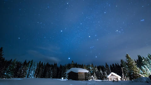 Little House on the background of the starry sky with clouds in winter Footage