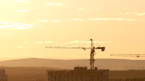 Tower crane against the sky in the afternoon. Backlight. Ekaterinburg, Russia Footage