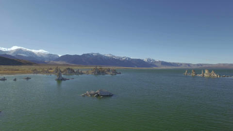 Tilt up aerial along beautiful mountain lake landscape Footage