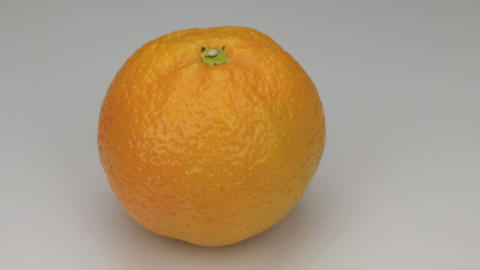 Orange mandarin rotates on its axis Live Action