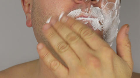 Closeup shave a man, use shaving foam on face Footage