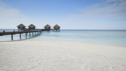 Private Bungalows on Pier at a Vaadhoo Island Resort Footage