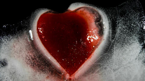 Red heart in ice melting, bleeding, with ALPHA MATTE Footage