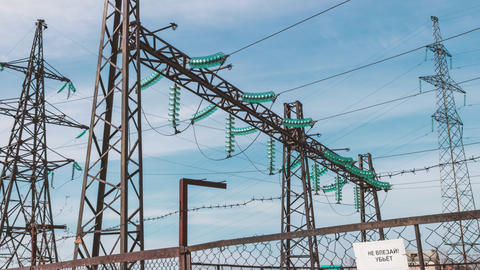 Electric high-voltage substation. Renewable clean energy. Electric generators Live Action