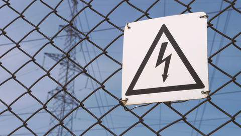 Warning sign of danger. High - voltage electrical substation. Probability of Footage