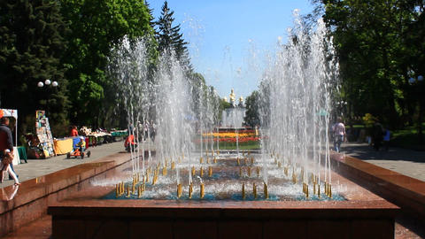People have a rest in park with fountains Footage