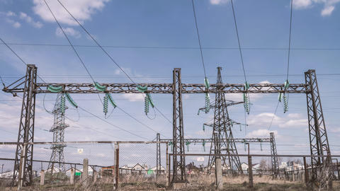 Electrical engineering structures at a power plant. High-voltage wires on Footage