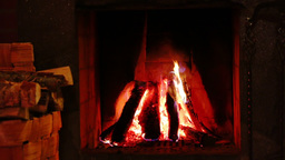 Fire in the Fireplace and Basket of Firewood. Real Audio Footage
