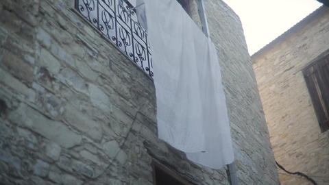 White Cloth Hanging On The Facade Of The Building Footage