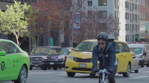 Cars and people and the intersection of New York slow motion Footage