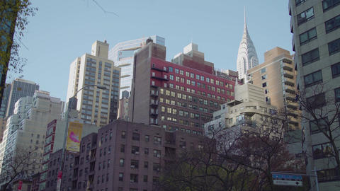 Rockefeller Center through many buildings NY Live Action