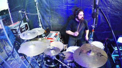 Musician Beats on Drums Set at Evening Concert Closeup Footage