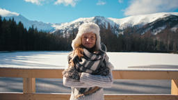 Winter Portrait of Lady in Fur Hat with Nice Mountains and Snow at Background Footage