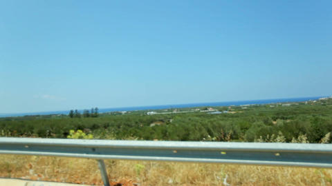 POV vehicle driving across beautiful green nature, mediterranean coast landscape Footage