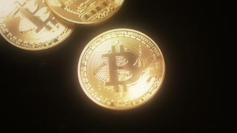 Bitcoins on black background dreamy focus ビデオ