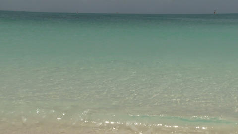 Clear water waves on island beach Live Action