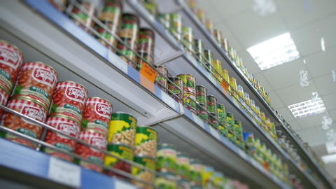 food on the shelves of the supermarket, canned food Live Action
