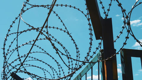 A fence of barbed wire. Closed territory. Unauthorized entry is prohibited Footage