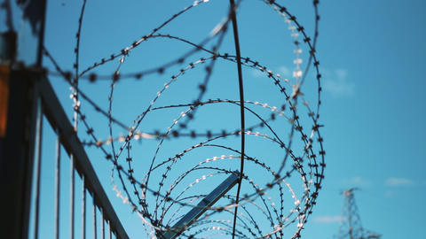Barbed wire fence. restricted area. Closed territory. Warning of danger Footage