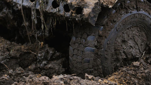Close-up of a car wheel stuck in the mud. Wheel is spinning, but it helpless Footage