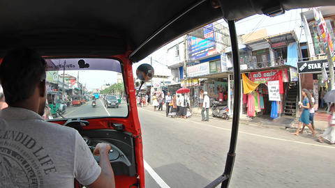 Tuk tuk ride through downtown Hikkaduwa. Sri Lanka Footage