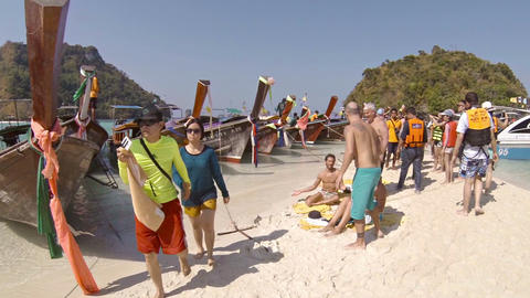 Dense crowd of tourists on small beach between boats. Tup island. Thailand Footage
