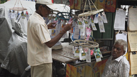 Slow motion abstract of lottery ticket vendors in Colombo Footage
