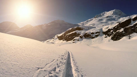 Snow landscape winter mountains hikers paths aerial view fly over Footage