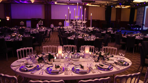 a wonderfully designed wedding room and dining tables Live Action
