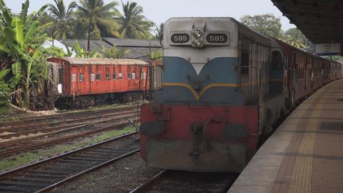Diesel powered passenger train. arriving at rural station in Sri Lanka Footage